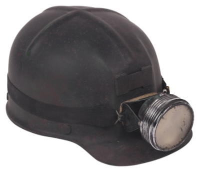 old mining hardhat with head light