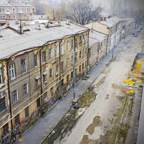 dirty city streets and old dirty houses, sadness, poverty