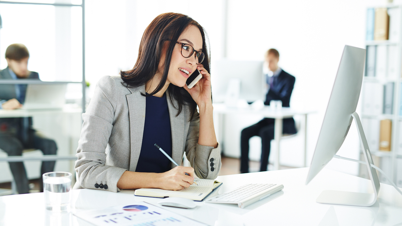 Business woman on phone, media buying agency