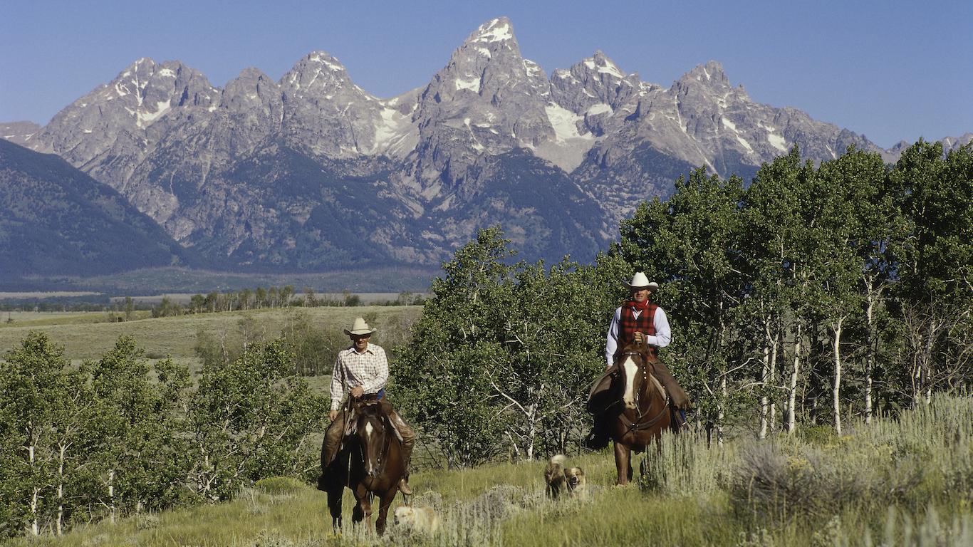 Kellly, Wyoming Cowboys working
