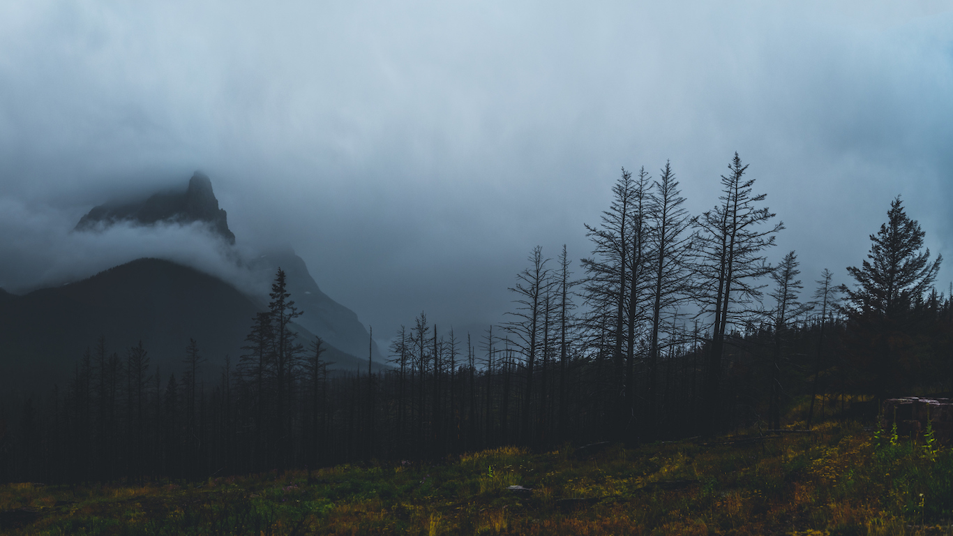 mountain peaks covered in clouds Montana