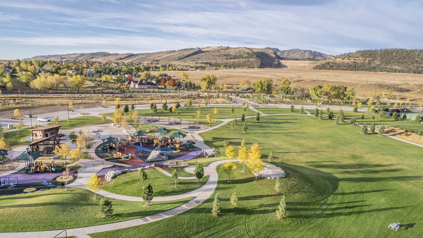 aerial view of park and playground at foothills of Rocky Mountains in Fort Collins, Colorado, shot from a low flying drone